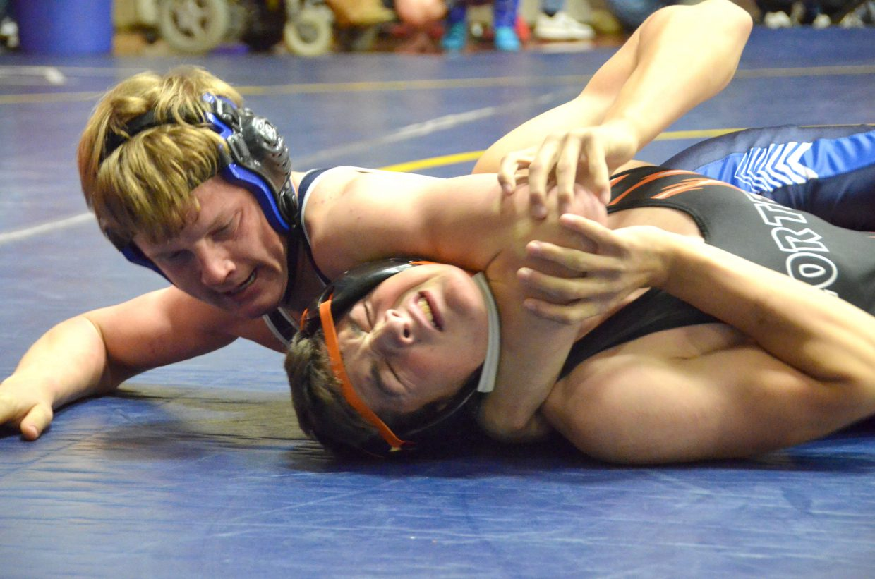 Moffat County High School's Isiaih Herod gives Montezuma Cortez's Shawn Higgins little breathing room during the Warrior Classic.
