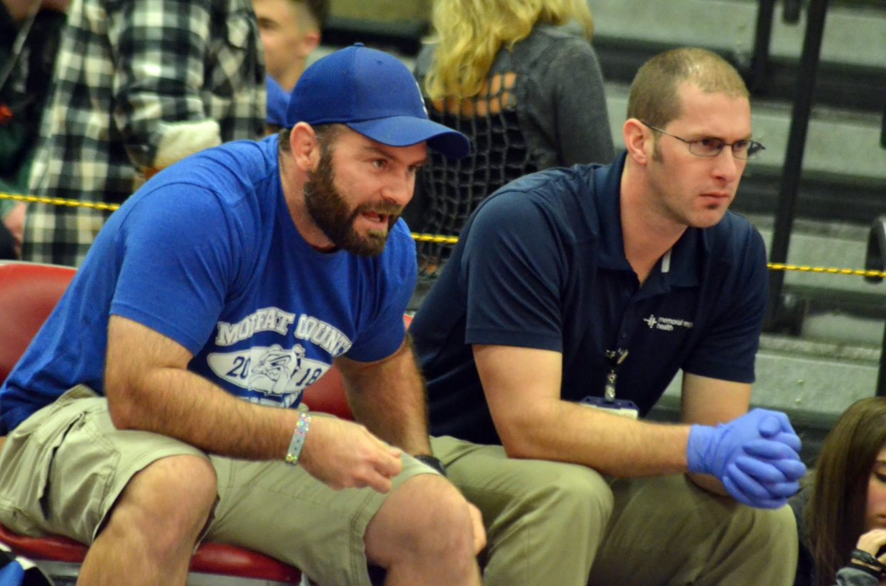 Moffat County High School's head coach Dusty Vaughn, left and trainer Marshall Kraker provide guidance during the Warrior Classic.
