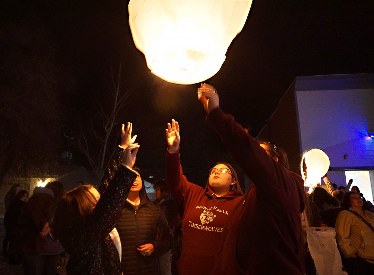The lantern is released to float away into the night sky.