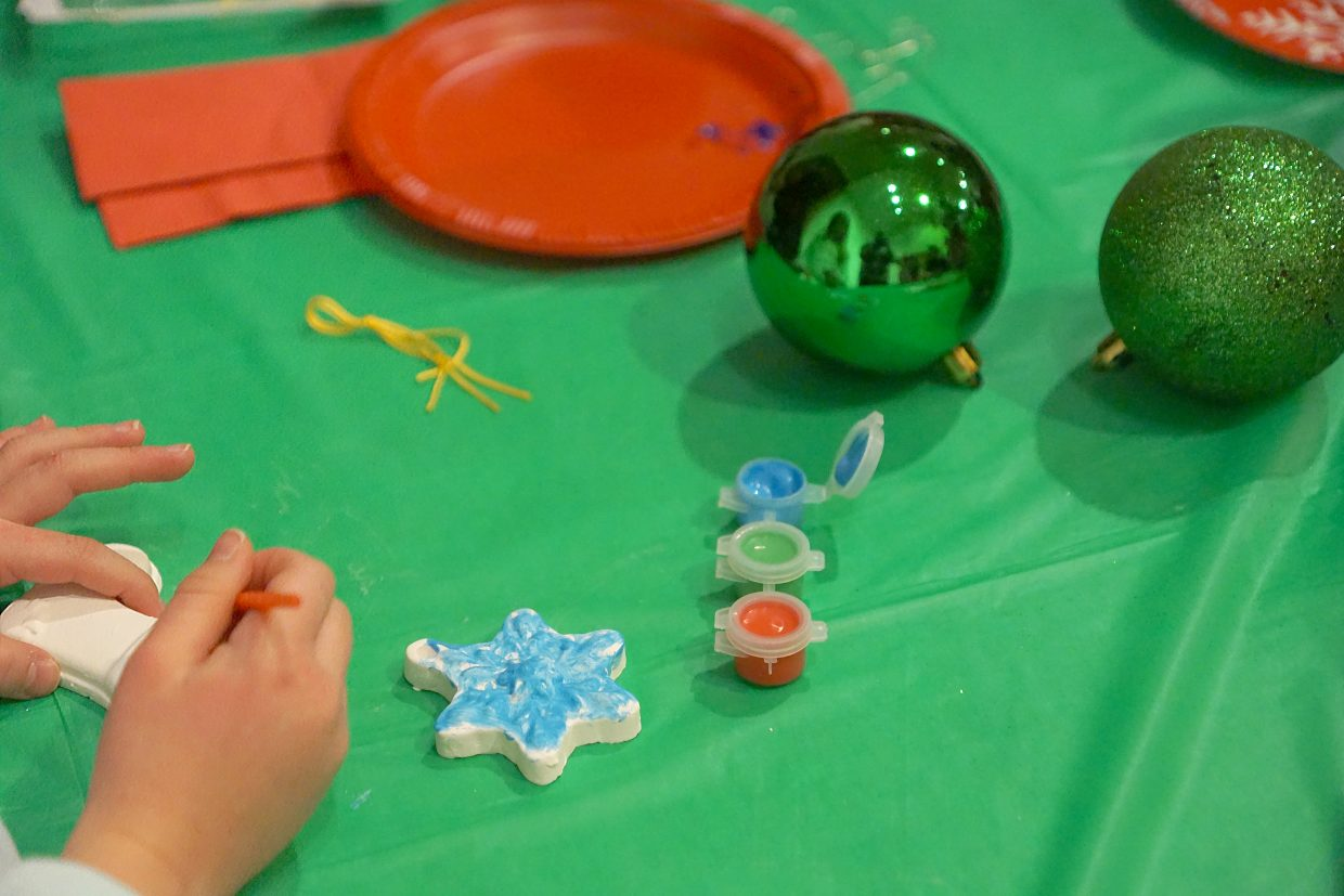 Children decorate cookies and Christmas tree ornaments during the Celebration of Light.
