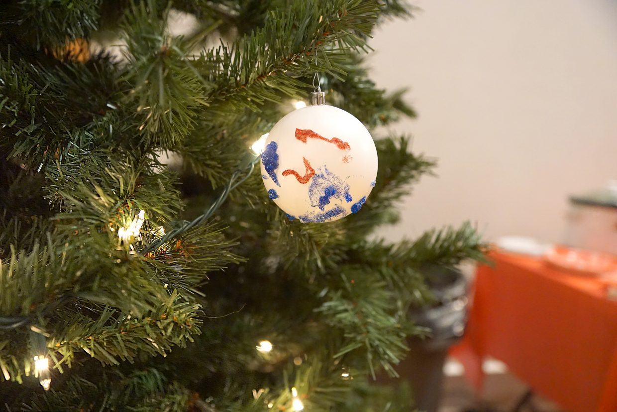 An ornament made by a child decorates a Christmas tree at the Celebration of Life.