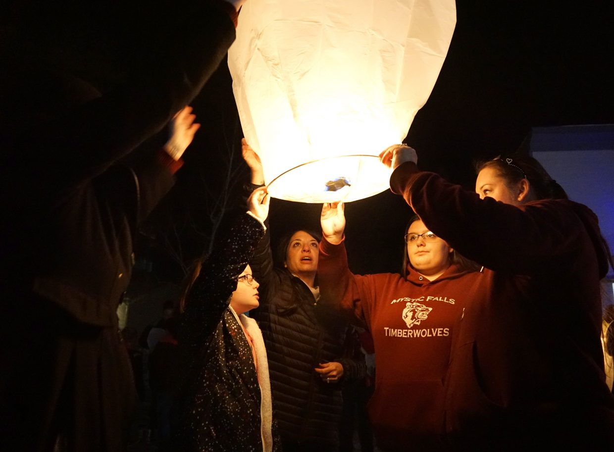The lantern is held up as it fills with hot air.
