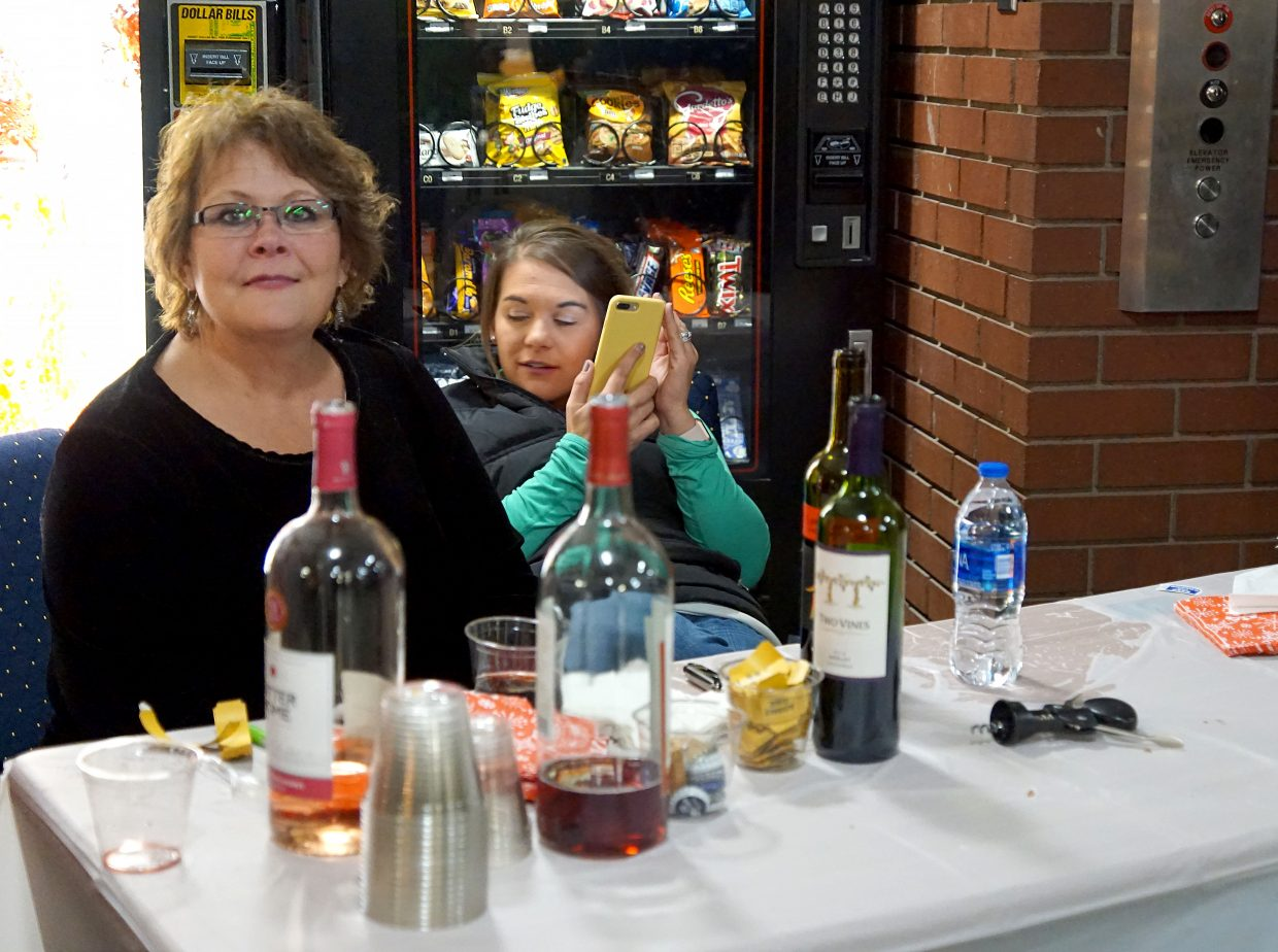 Moffat County Clerk and Recorder Lila Herod offers wine and beer to adults attending the Festival of Trees mixer.