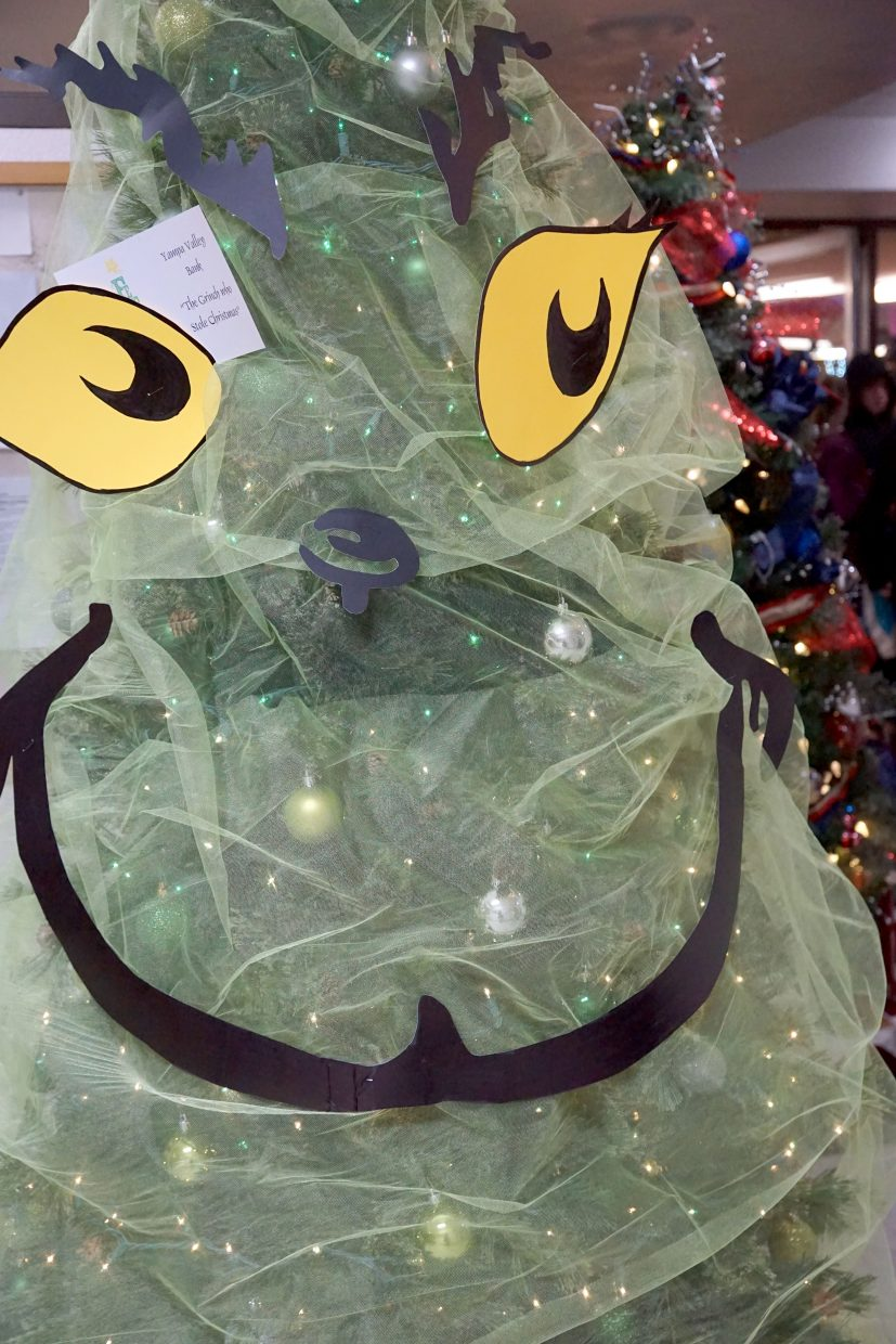 Even the Grinch is grinning with holiday cheer.