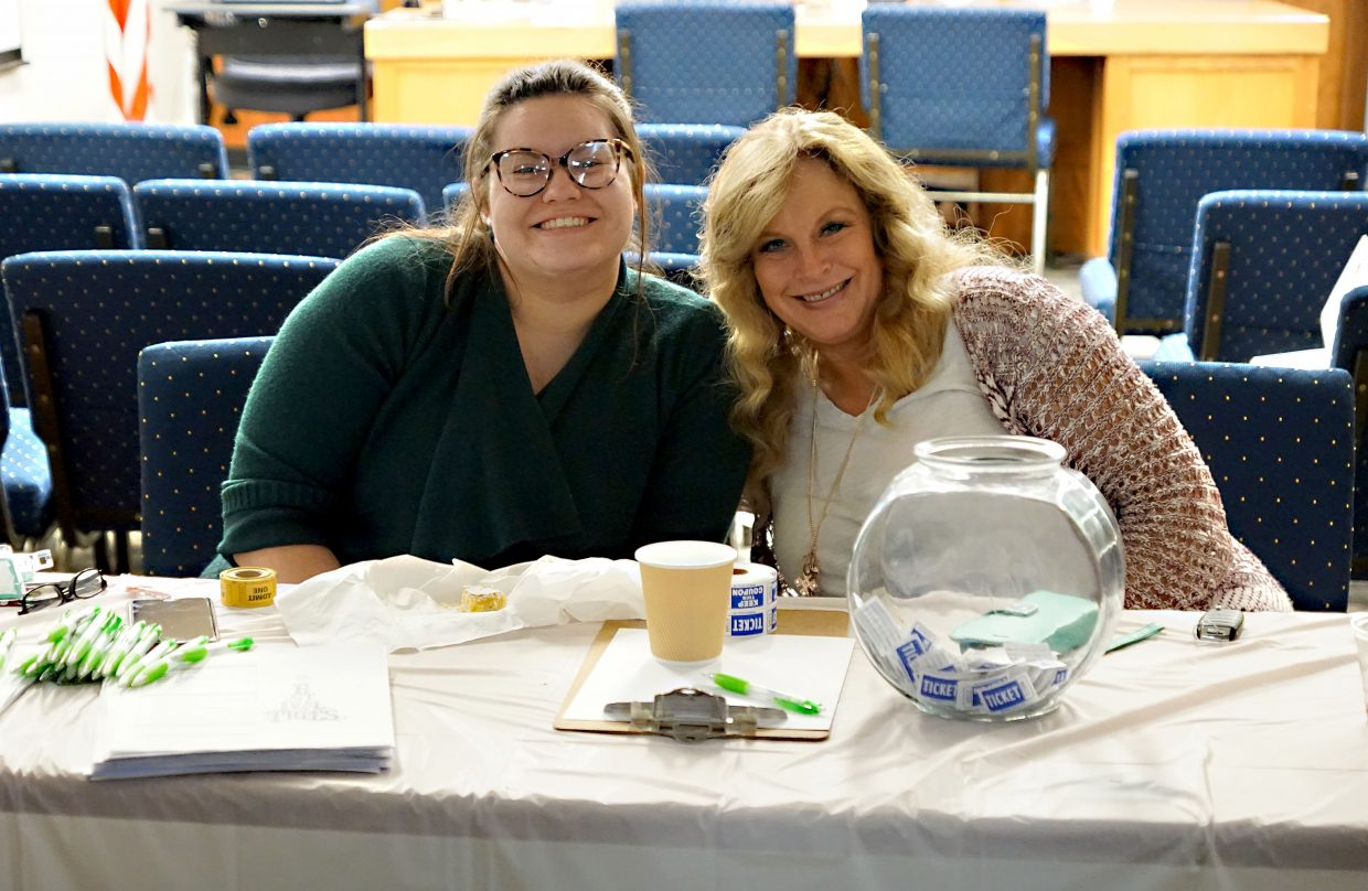 Guests of the mixer were encouraged by Bonnie Flanders, left, and Lora Stockman, to enter a drawing for door prizes.