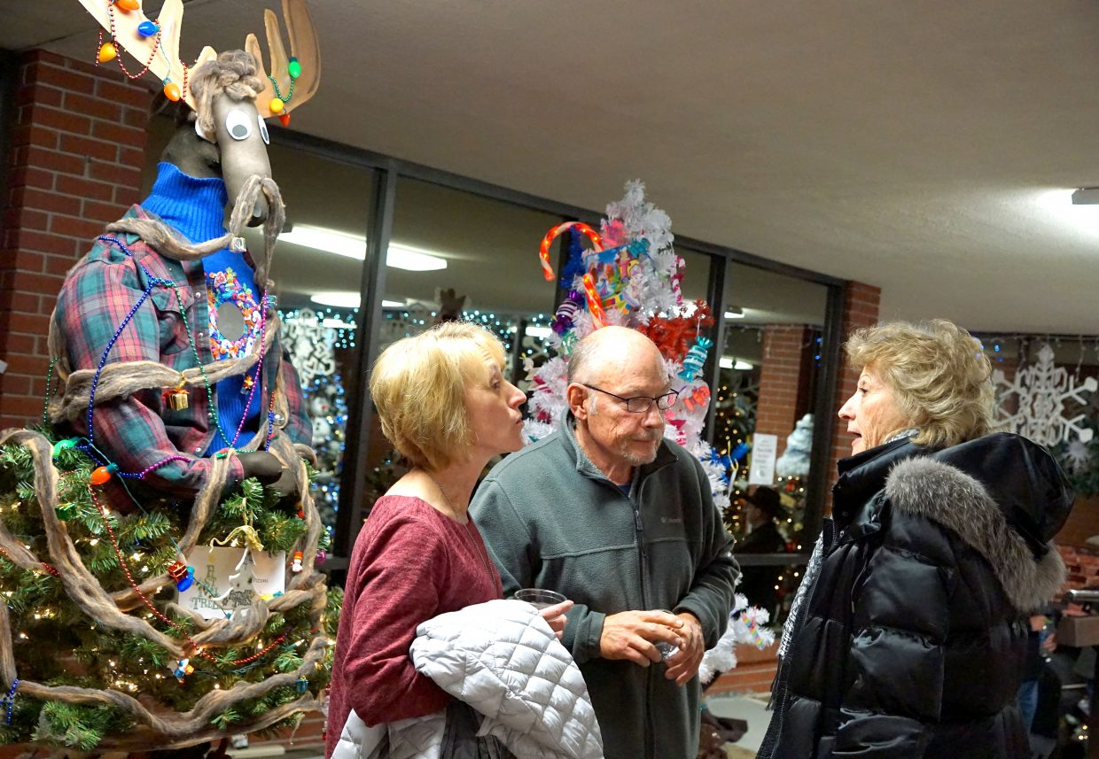 Brenda Elsbury, Chris Nichols, and Vicki Burns enjoy one another's company during the after-hours event at the courthouse.
