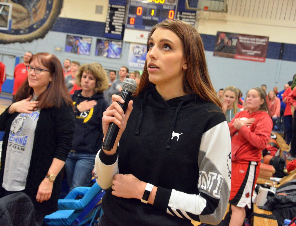 Moffat County High School's Eliana Mack performs the national anthem.