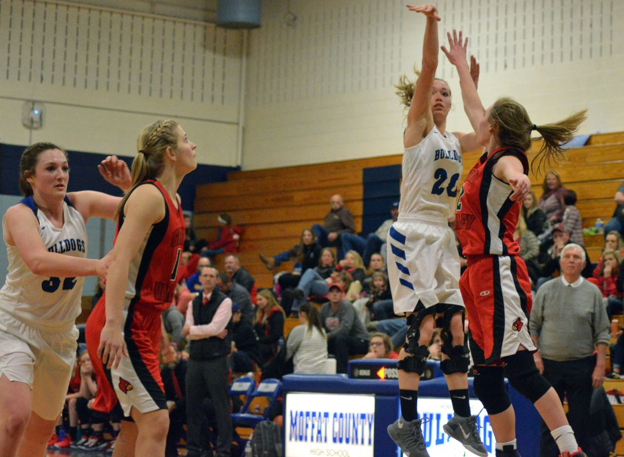 Moffat County High School's Madie Weber shoots a lengthy jumper.