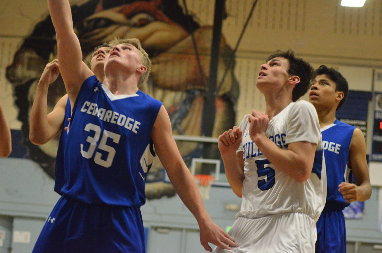 Moffat County High School's Jerod Chacon backs off from the basket only once the ball hits net.