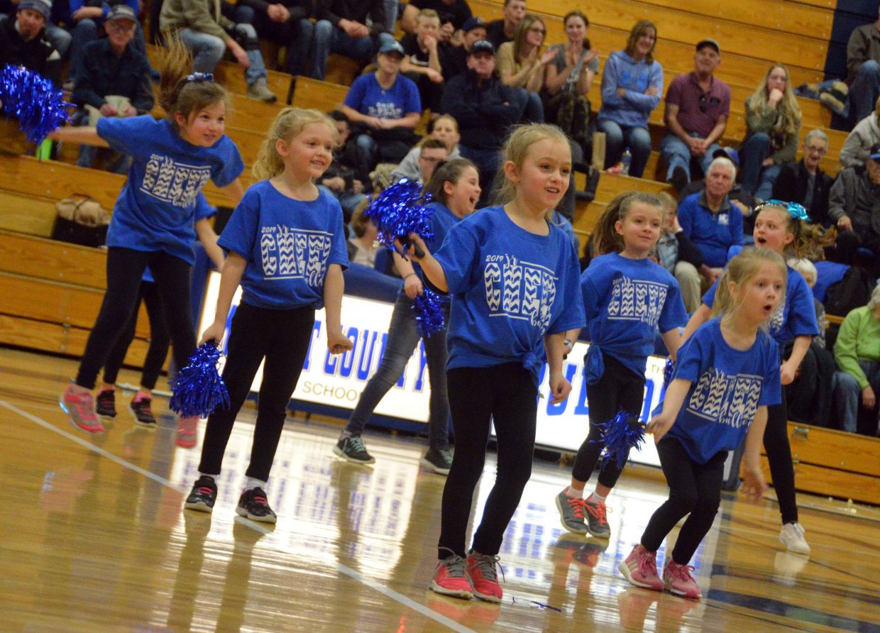 Members of the Moffat County High School Junior Cheer Clinic show their energy during a halftime show.