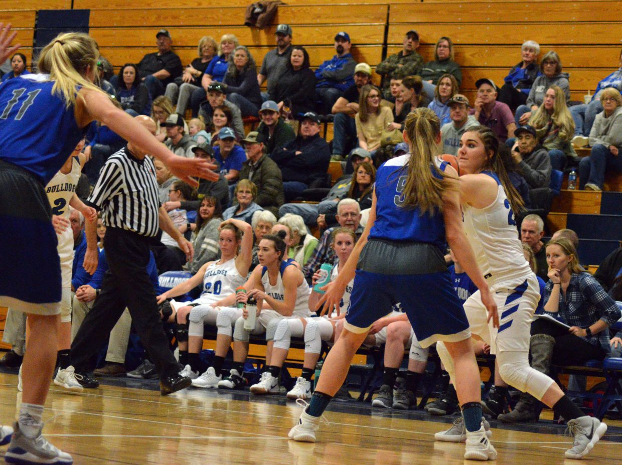 Moffat County High School's Jenna Timmer looks to get out of a tight squeeze.