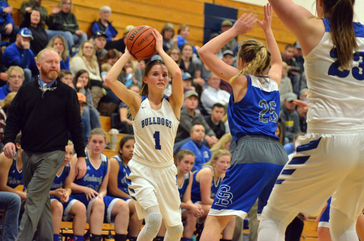 Moffat County High School's Stephenie Swindler locks eyes and looks to pass to teammate Jenna Timmer.