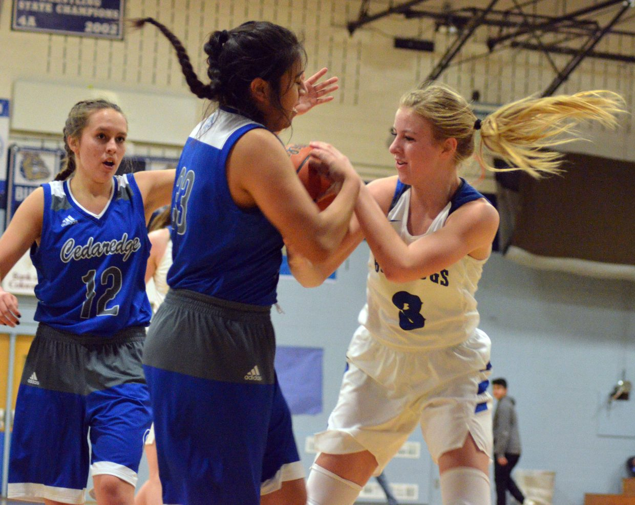 Moffat County High School's Halle Hamilton fights for the rock.