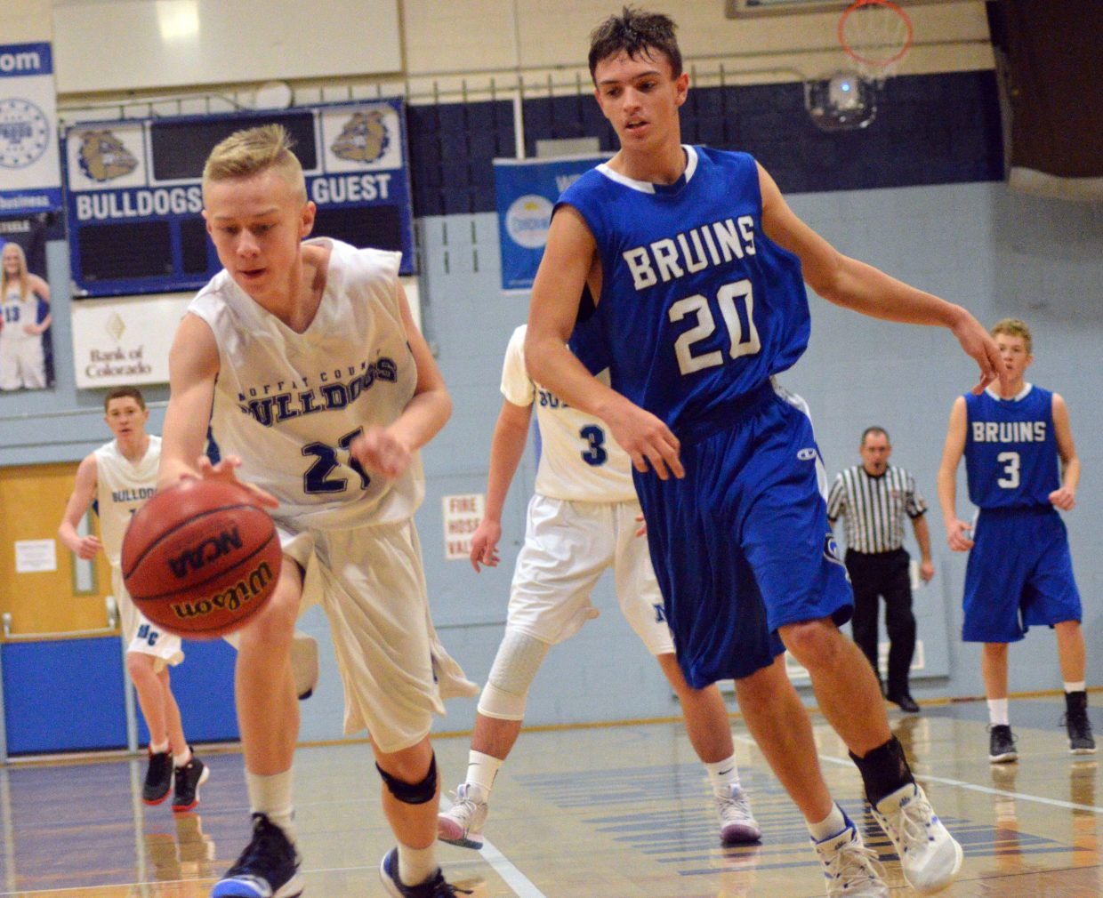 Moffat County High School's Chris Maneotis recovers a loose ball during boys JV basketball