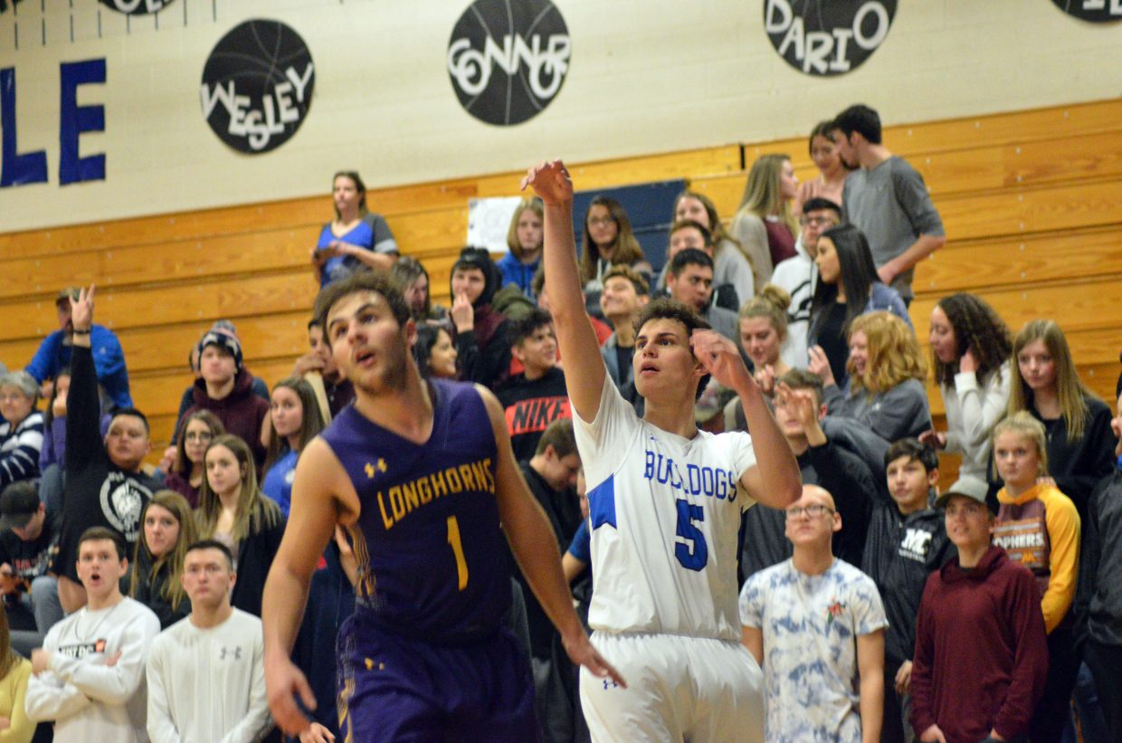 Moffat County High School's Jerod Chacon beats a Basalt block to get off a three-point shot.