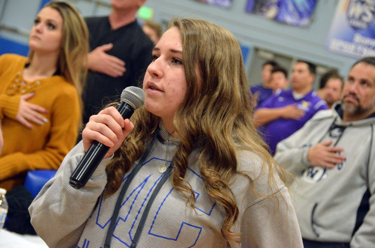 Moffat County High School's Alexa Neton sings the national anthem before the boys basketball game.