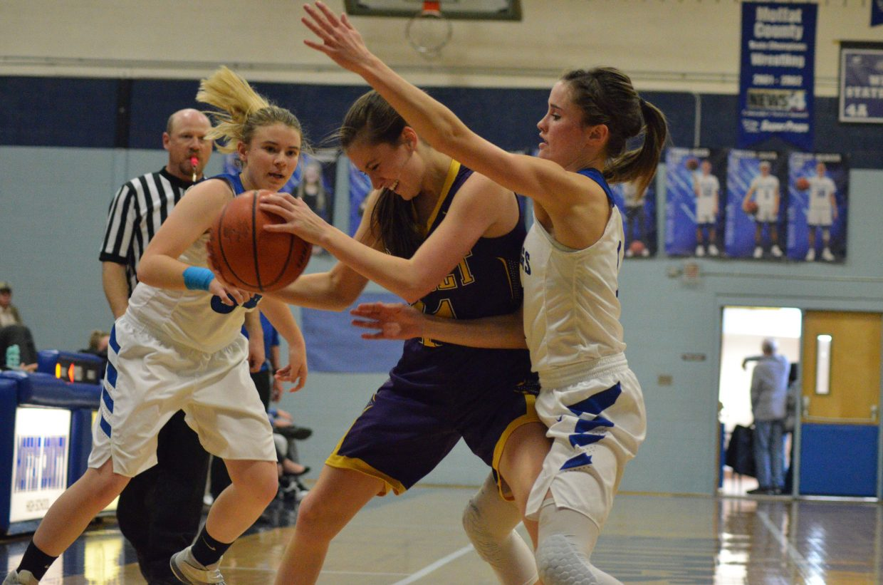 Moffat County High School's Brittnee Meats and Stephenie Swindler smother the Basalt offense.