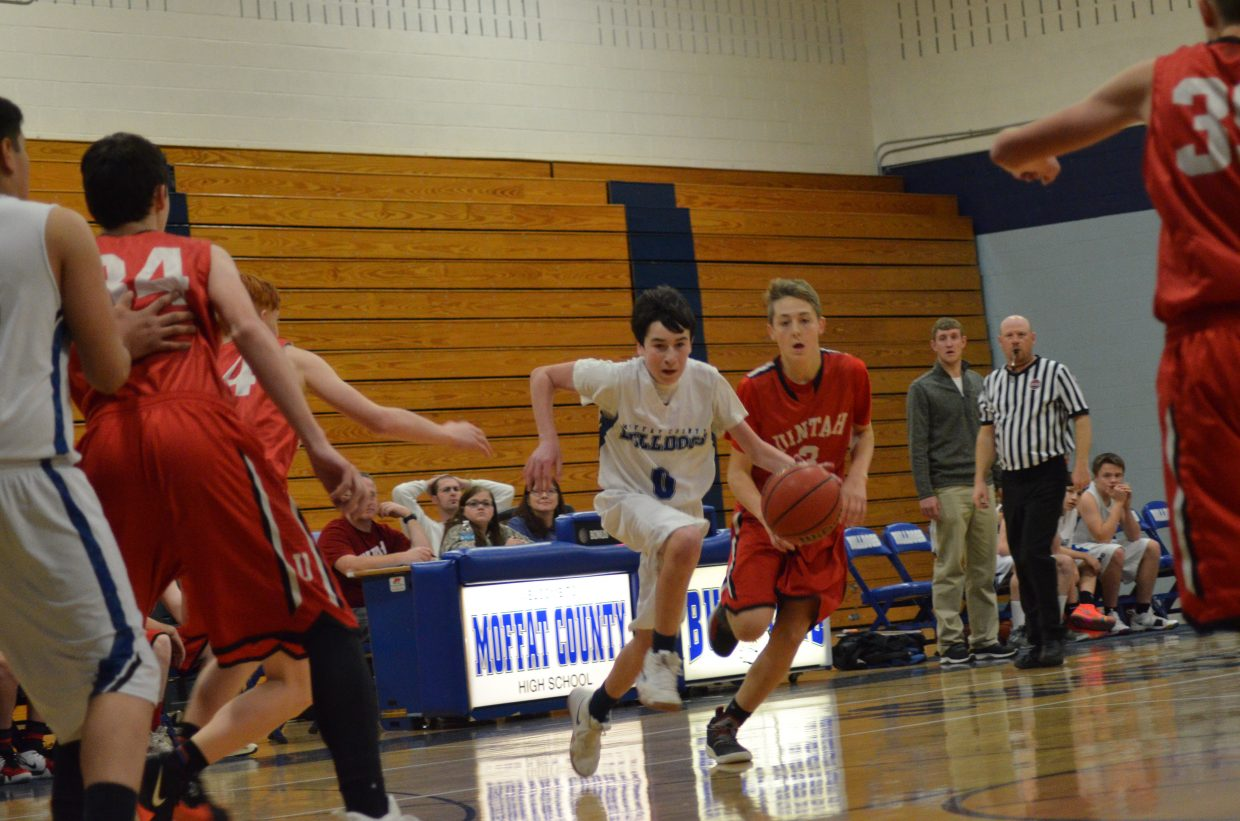 Moffat County High School's Tanner Etzler cuts across the court during Bulldog C-Team's Saturday home tournament.