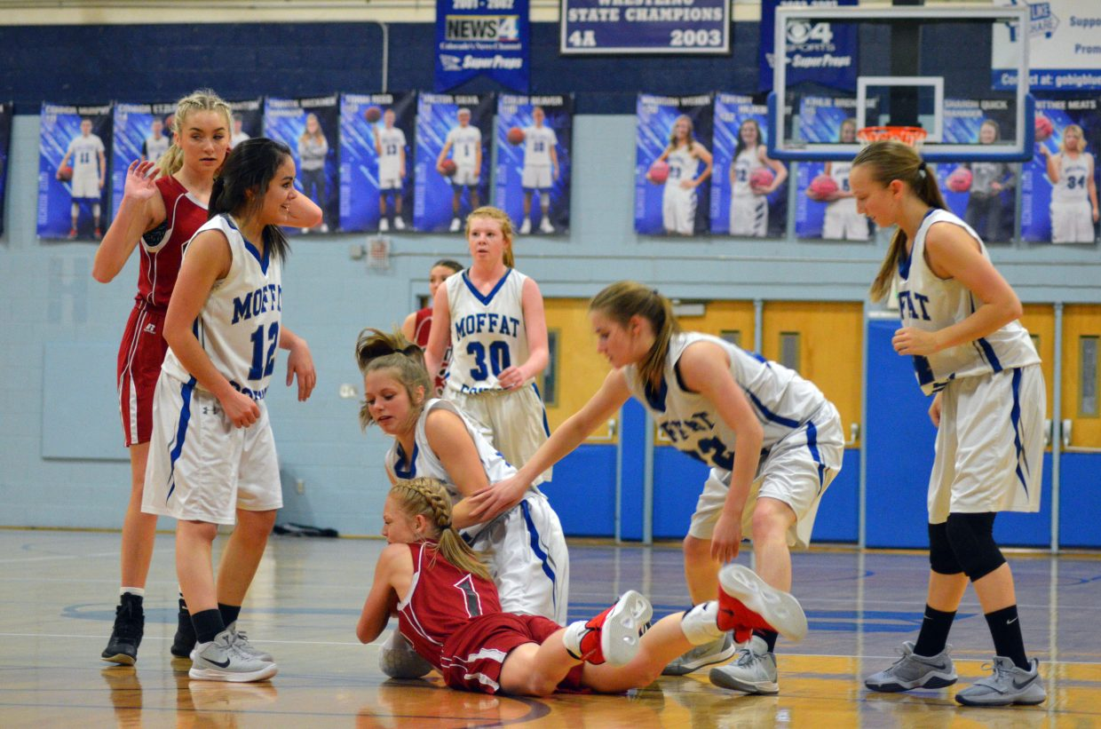 Moffat County High School's Emma Jones fights for the loose ball during Bulldog C-Team's Saturday home tournament.