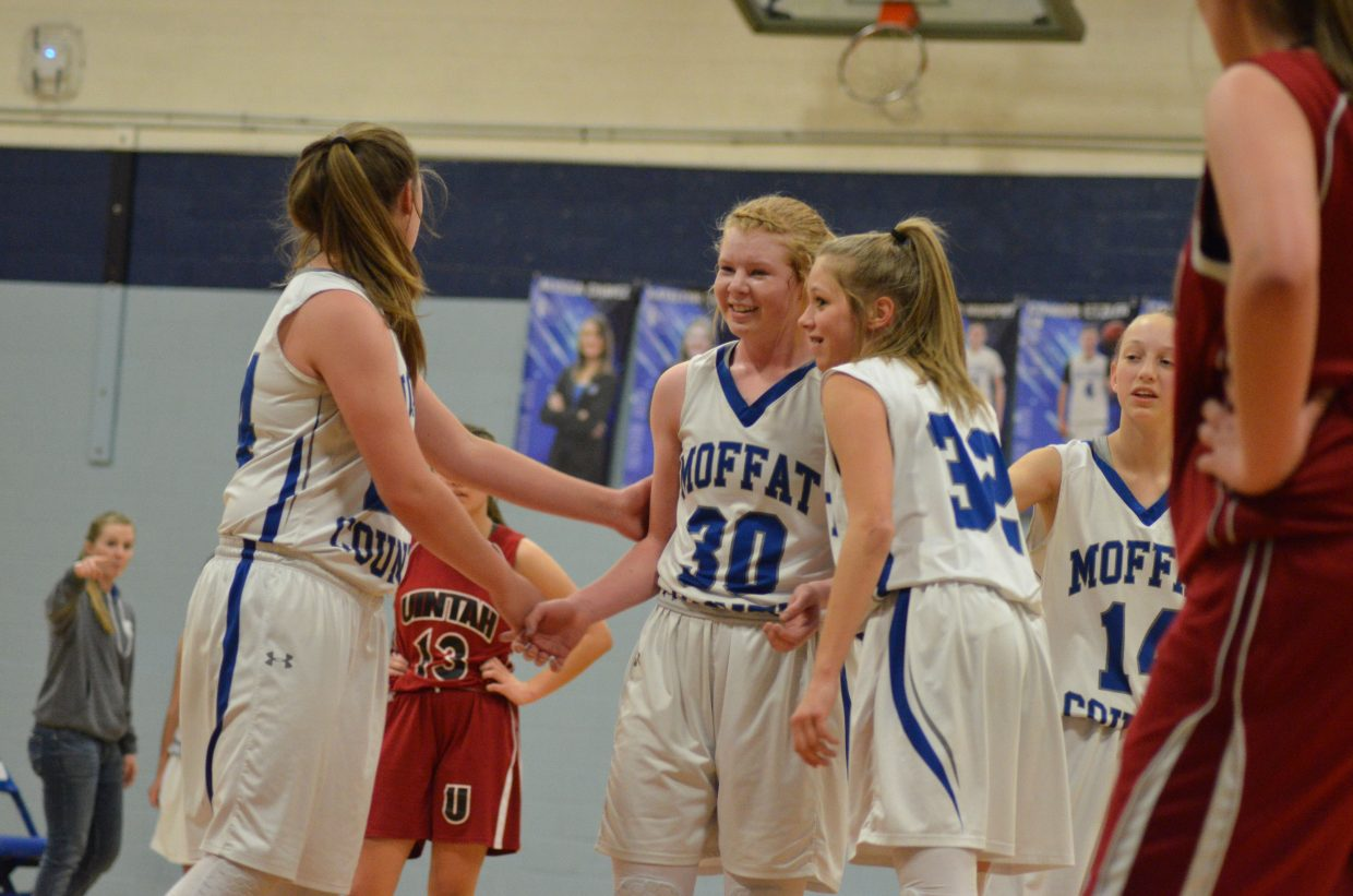 Teammates congratulate Moffat County High School's Bree Meats on a successful free throw during Bulldog C-Team's Saturday home tournament.