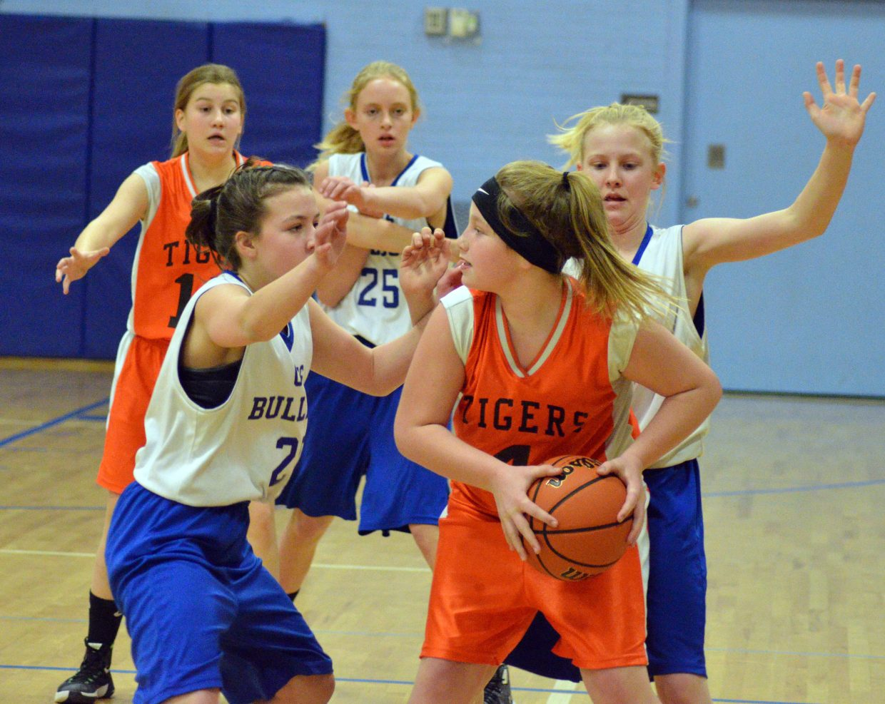 From left, Craig Middle School's Avery Atkin, Emelia Tucker and Katie Jo Knez swarm defensively against Hayden.