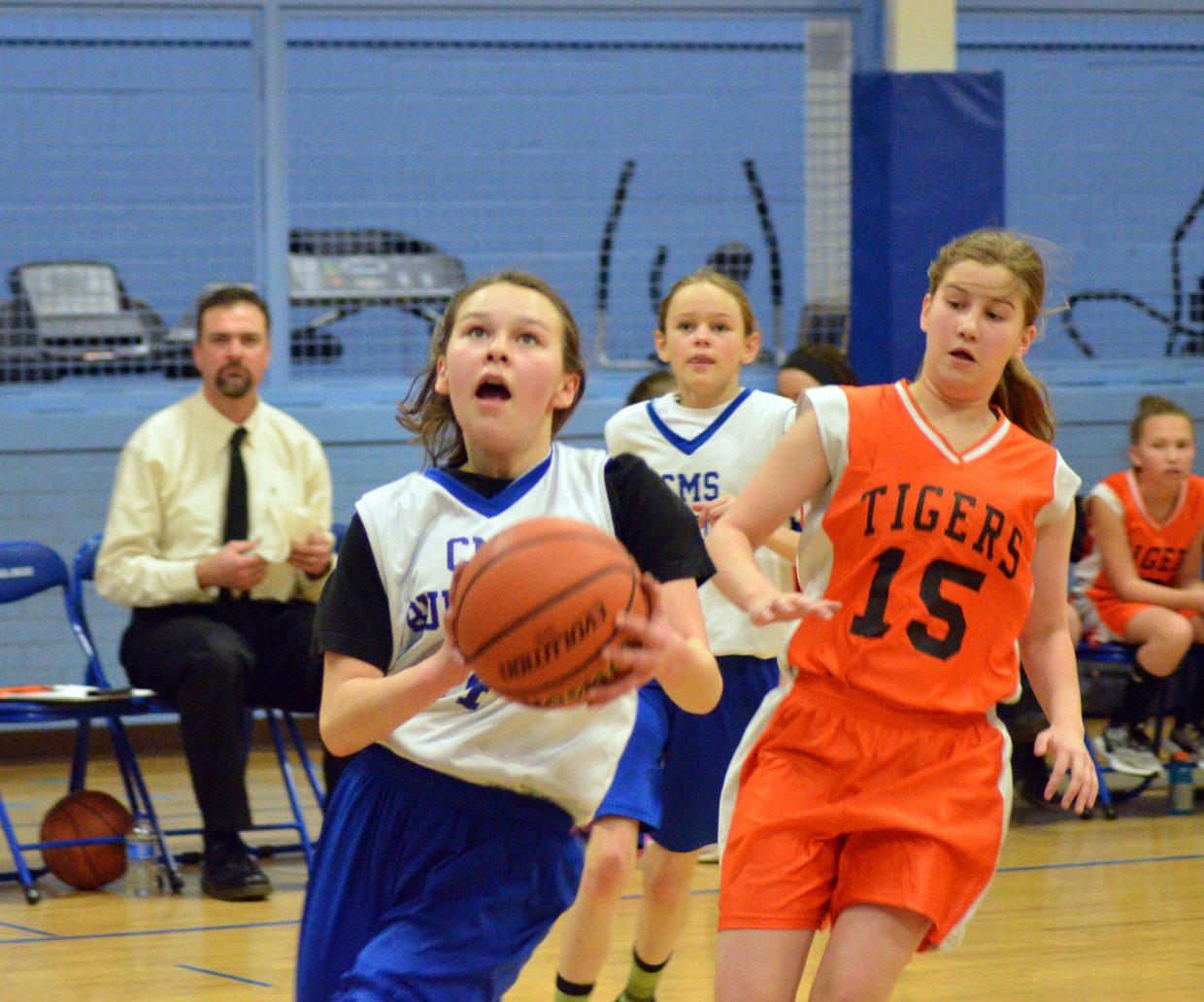Craig Middle School's Megan Neton closes in on a layup against Hayden.