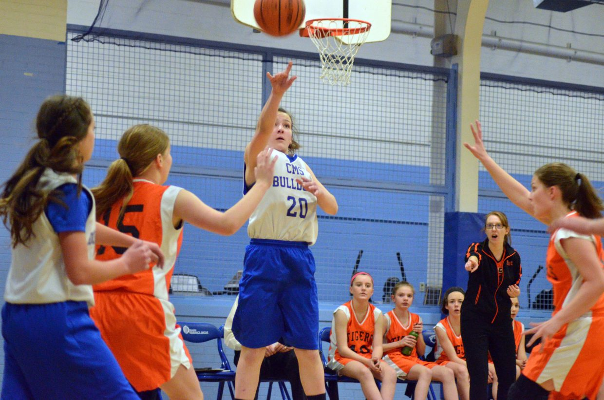 Craig Middle School's Avery Atkin shoots from the arc against Hayden.