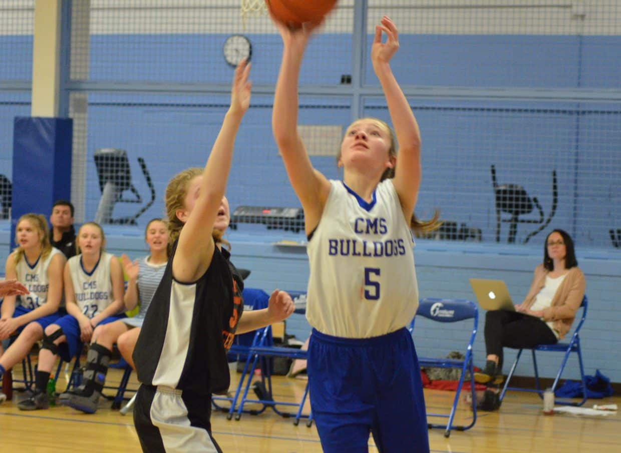 Craig Middle School's Lizzy LeWarne shoots from the low post against Hayden.