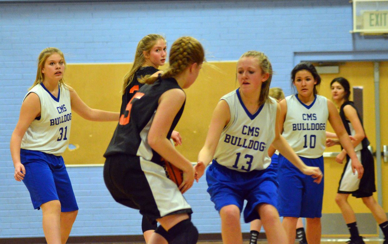 Craig Middle School's Marlee Fedinec looks to gain a steal against Hayden.