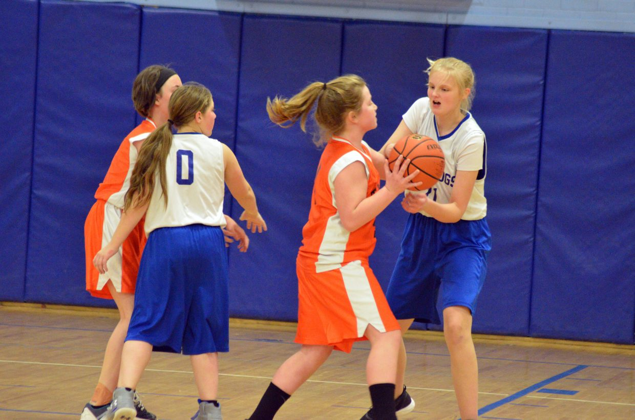 Craig Middle School's Hannah Crookston works to tear away the ball from Hayden.