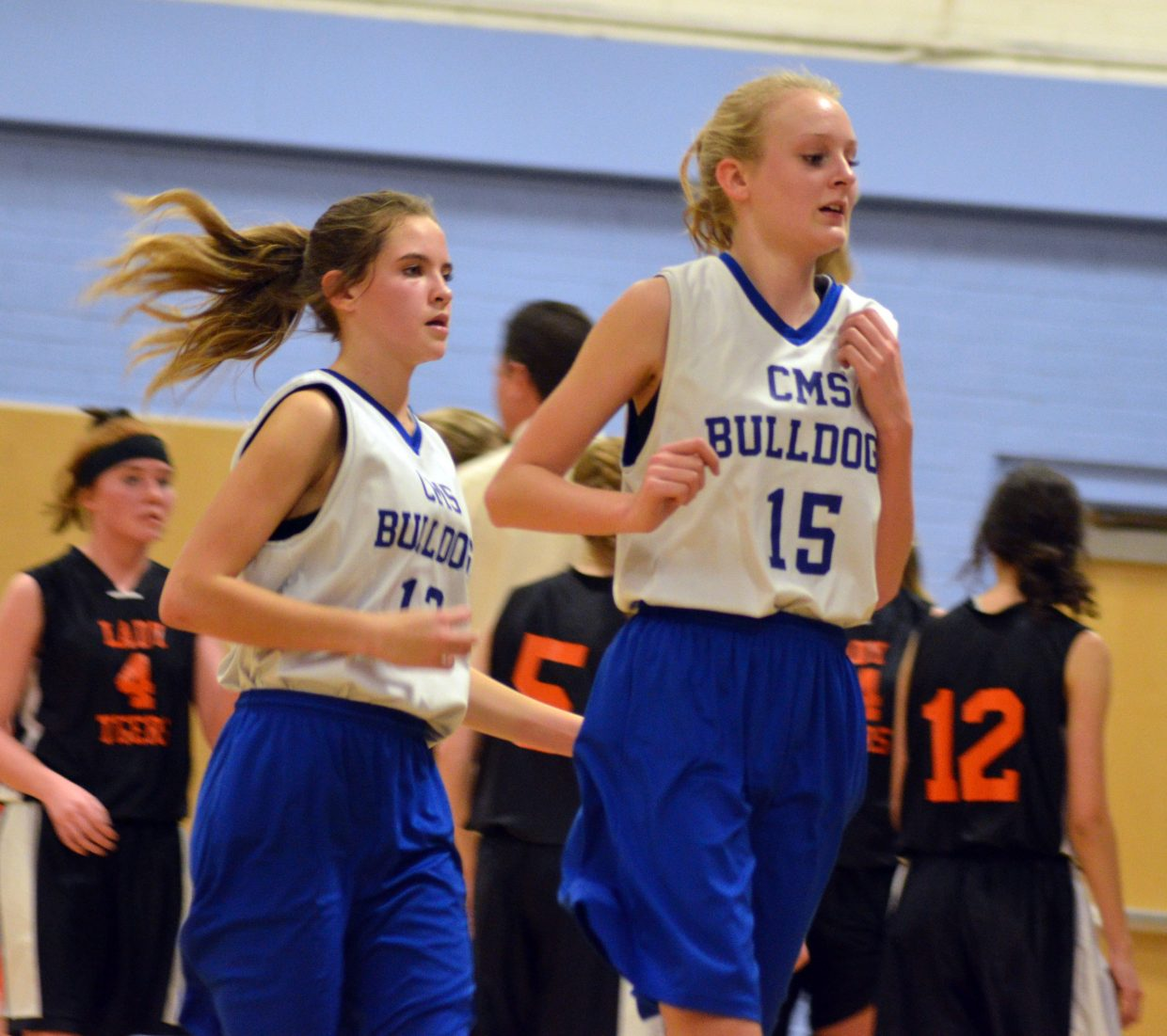 Craig Middle School's Cayden King and Sadie Smilanich rush to the bench during a timeout against Hayden.