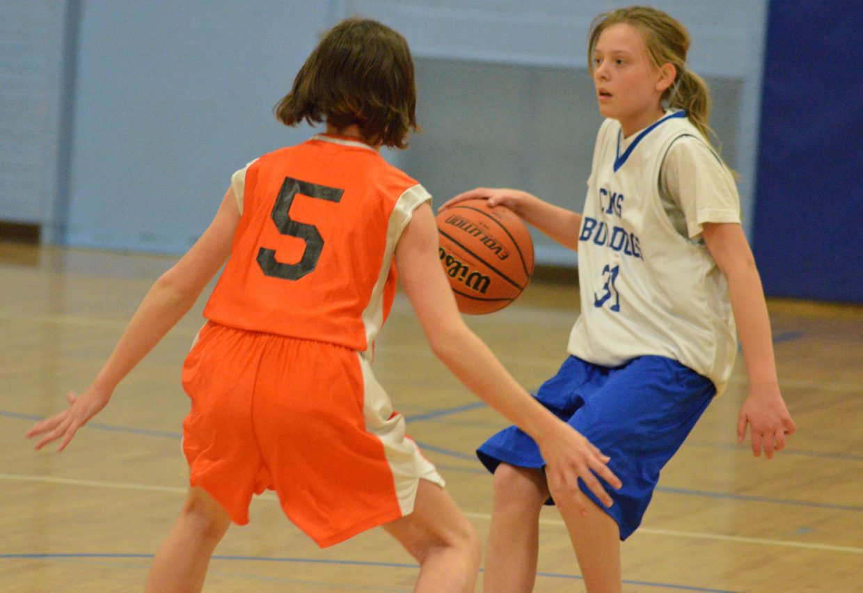 Craig Middle School's Kirsten Peed looks to make a move at half-court against Hayden.