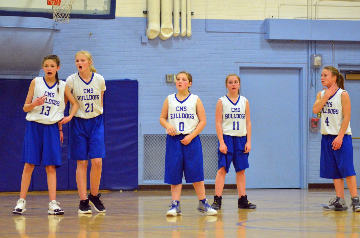 From left, Craig Middle School's Mattie Richards, Hannah Crookston, Abby Martinez, Jordis White, and Kiersten Chambers size up the opposition during a timeout against Hayden.