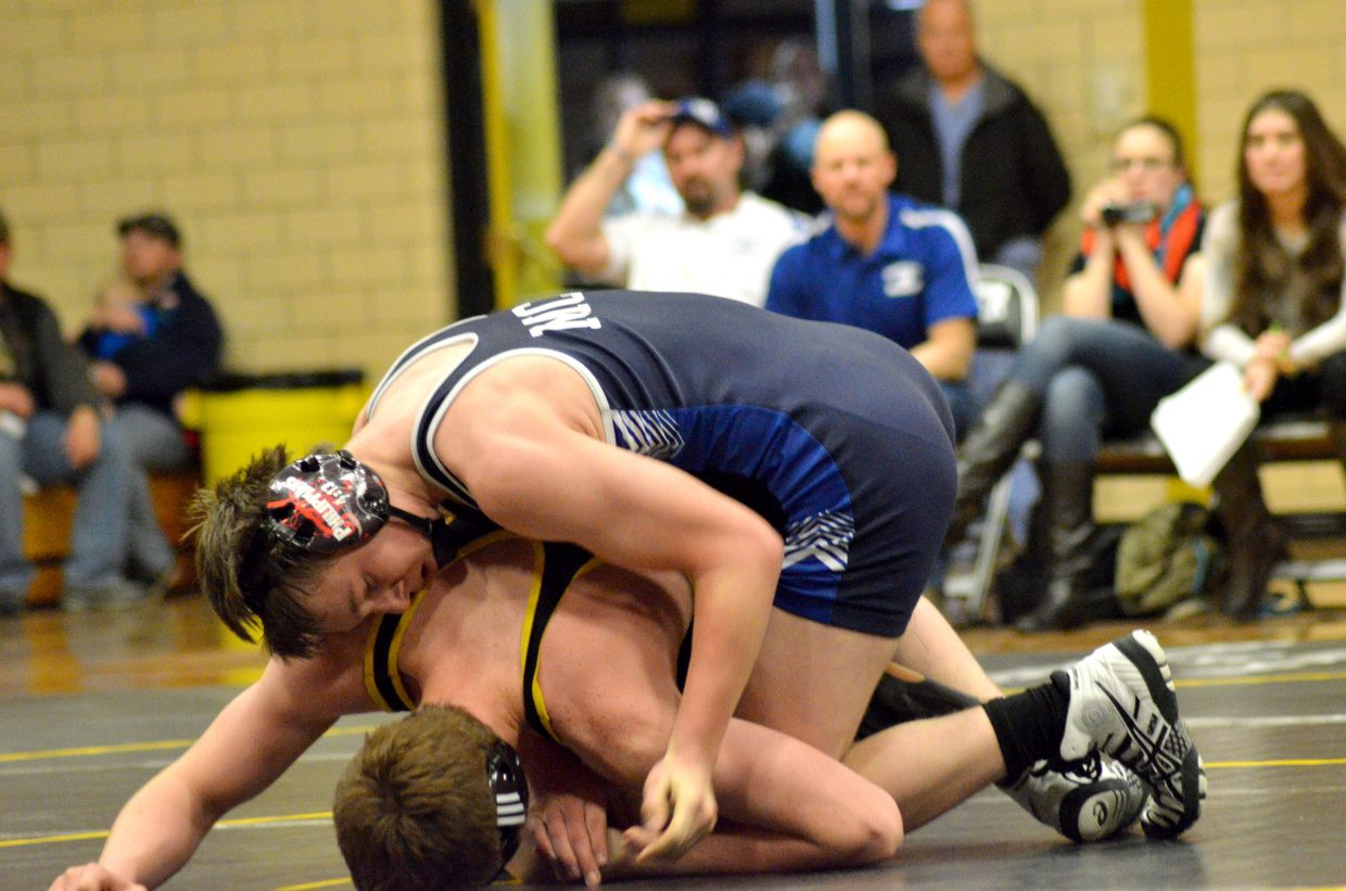 Moffat County High School's Pepper Rhyne and Meeker's Dax Sheridan vie for late points.