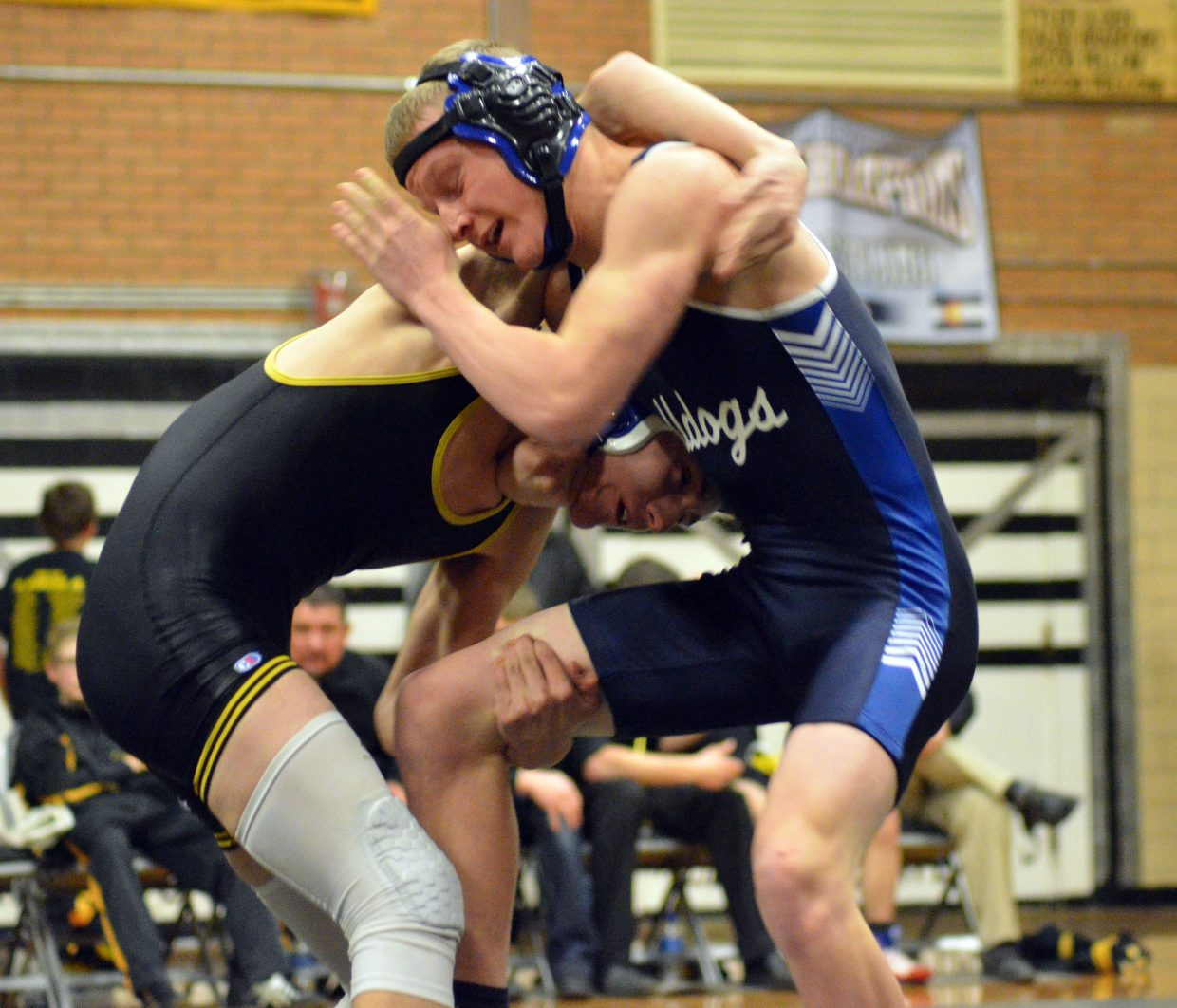 Moffat County High School's Isiaih Herod gets into the mix with Meeker's Tyson Portwood.