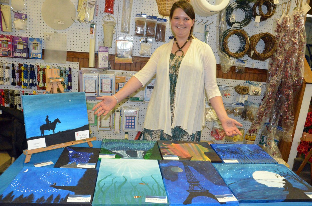 Mercy Longwell shows off her acrylic paintings during Art Walk and Taste of Chocolate in Sweet P's.