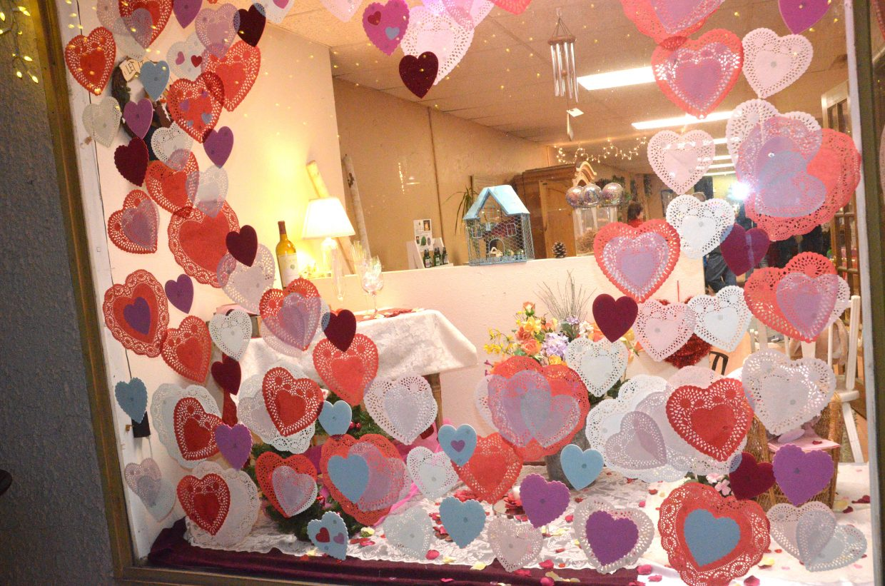 A Valentine's Day facade suits the front window of The Giving Tree during Art Walk and Taste of Chocolate.