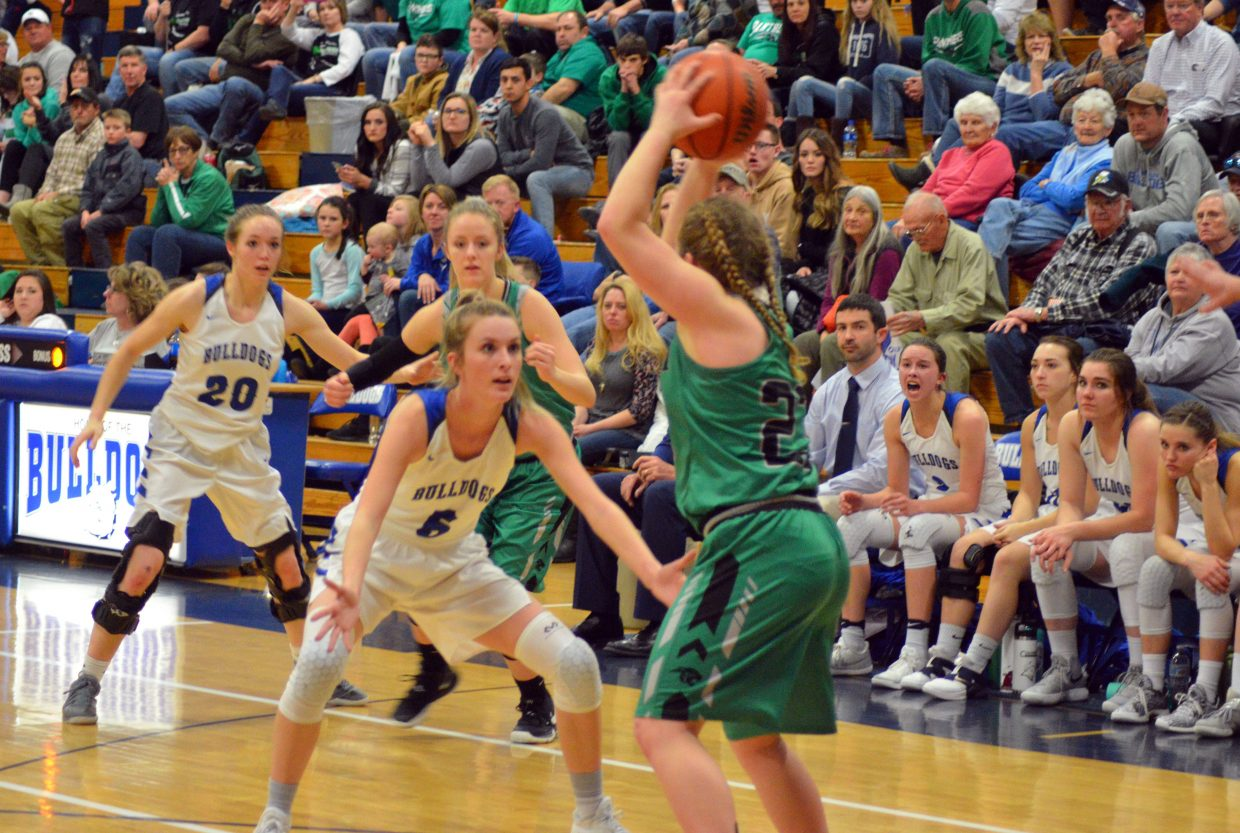 Moffat County High School's Madie Weber and Kinlie Brennise keep the defense going against Delta.