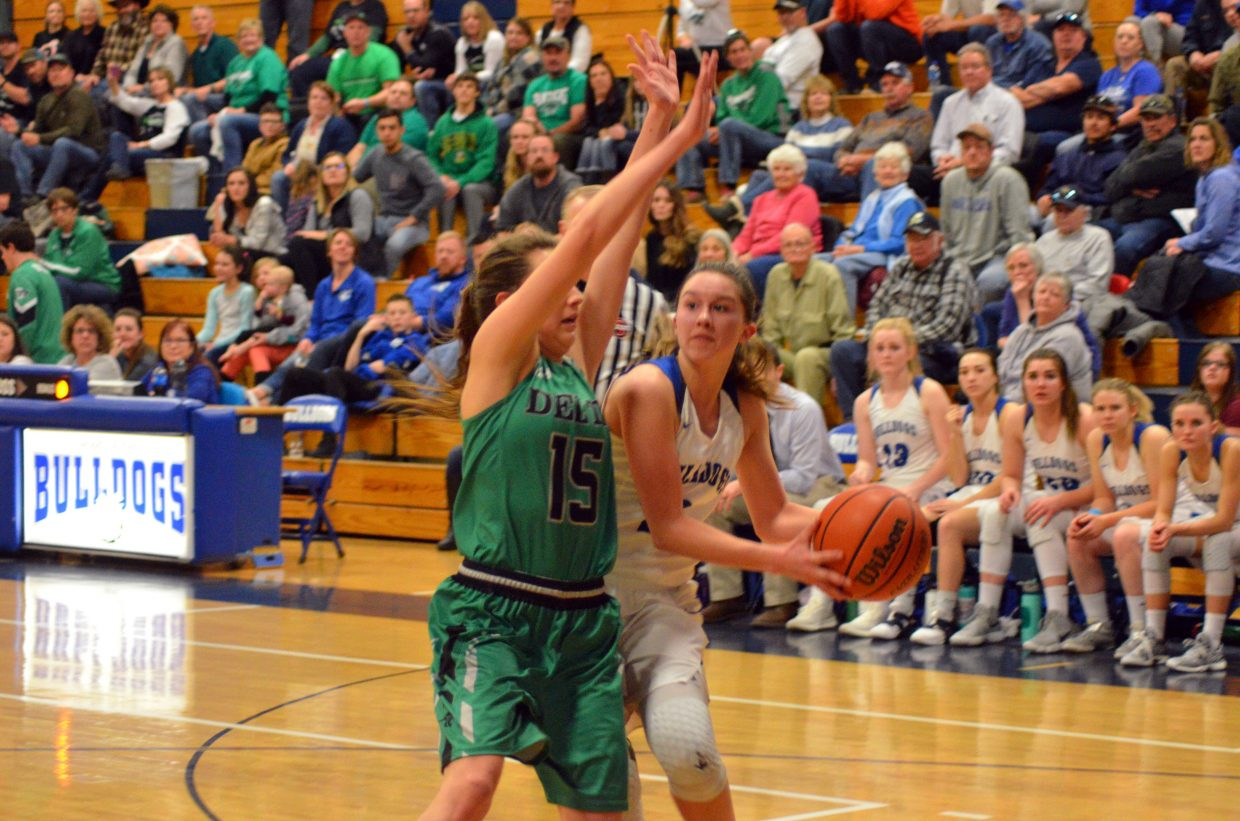 Moffat County High School's Emaleigh Papierski leans for a shot against Delta.