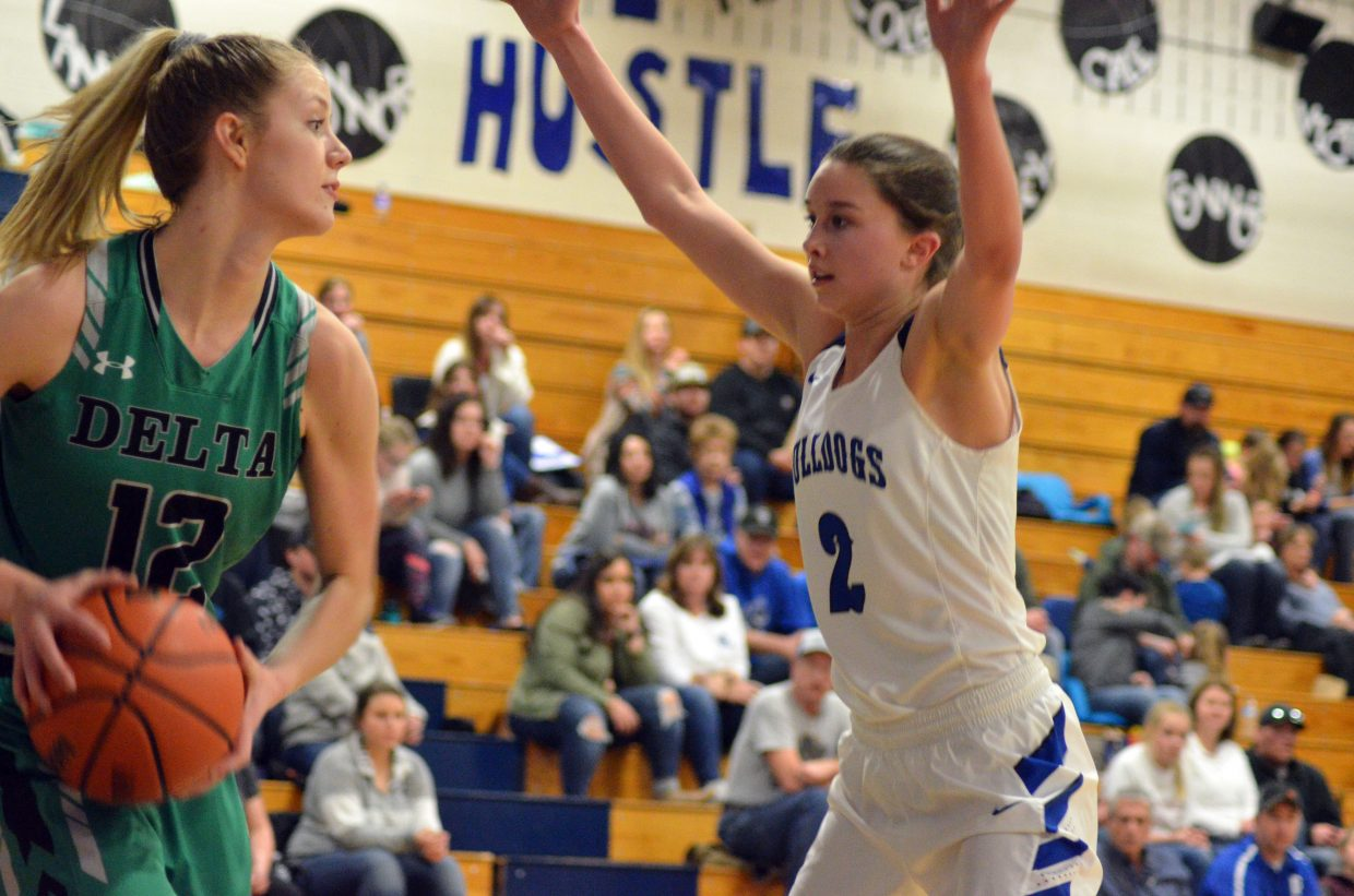Moffat County High School's Emaleigh Papierski stays in Delta's face.