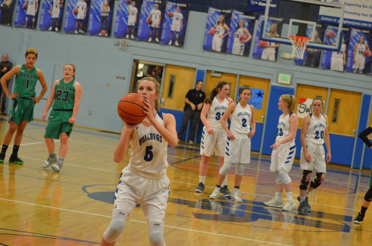 Moffat County High School's Kinlie Brennise is all alone at the foul line against Delta.
