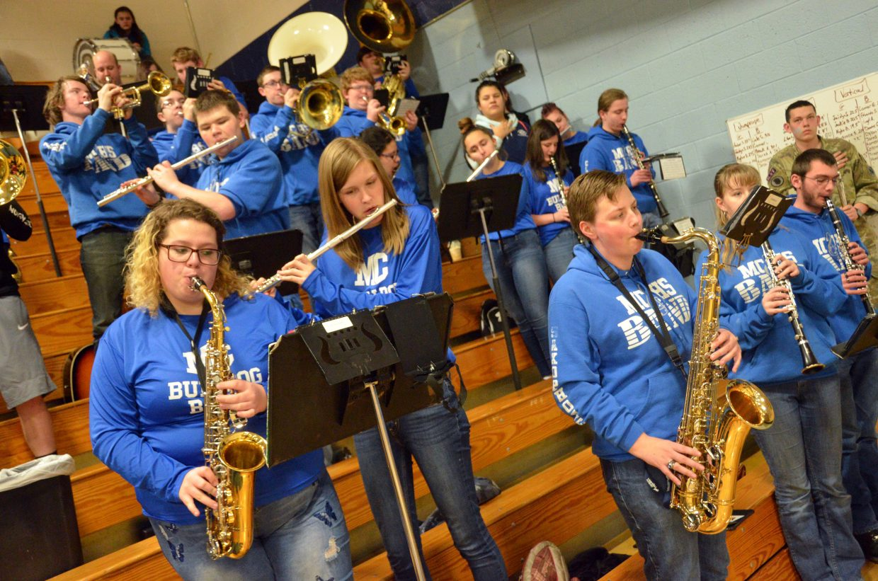 The Moffat County High School band performs the national anthem.