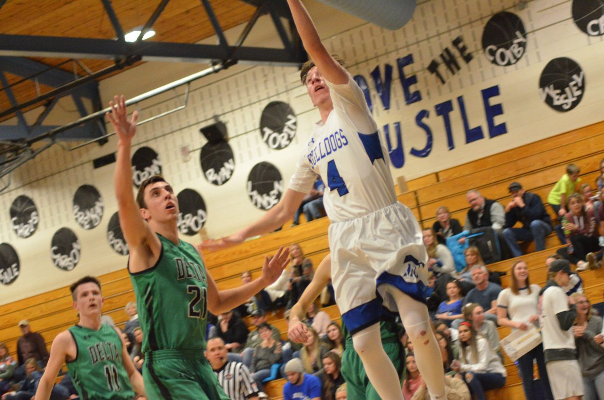 Moffat County High School's Connor Etzler leaps for a shot against Delta.