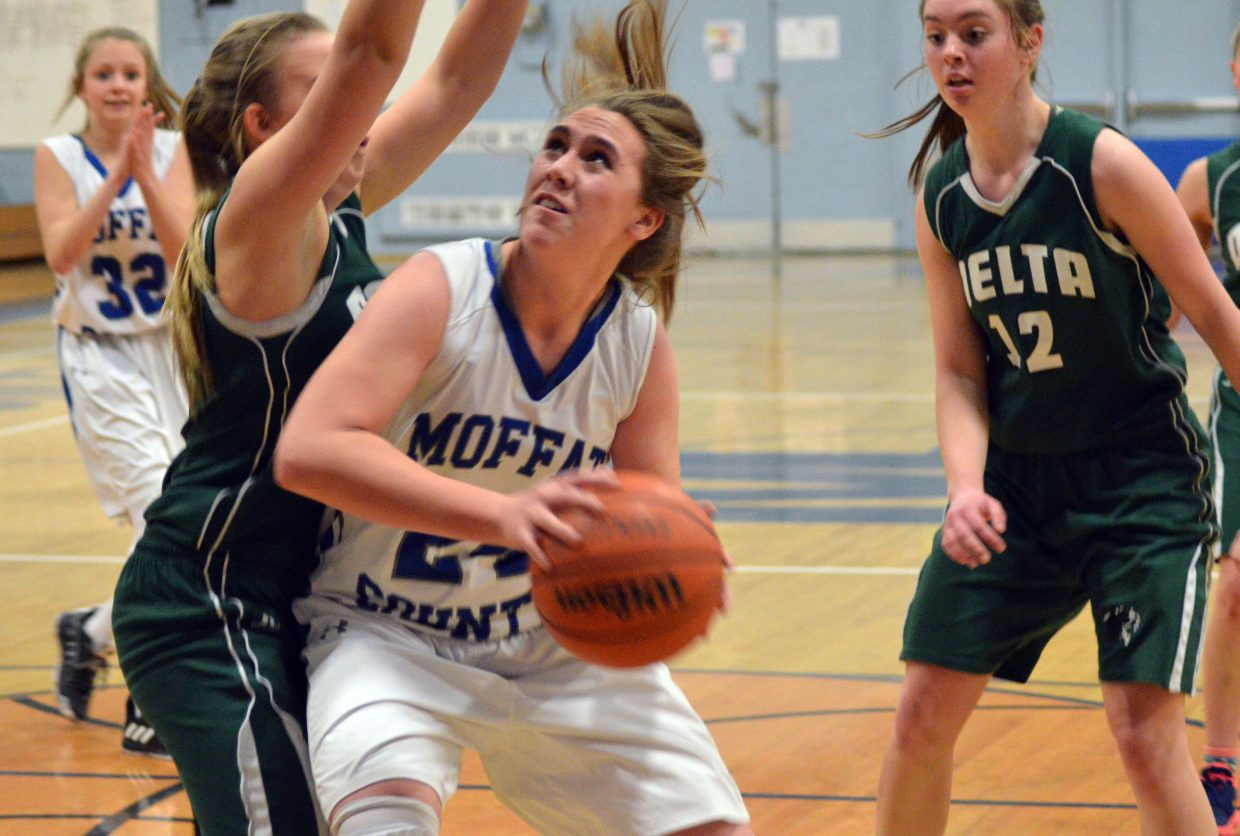 Moffat County High School's Amber Salazar forces her way forward against Delta.