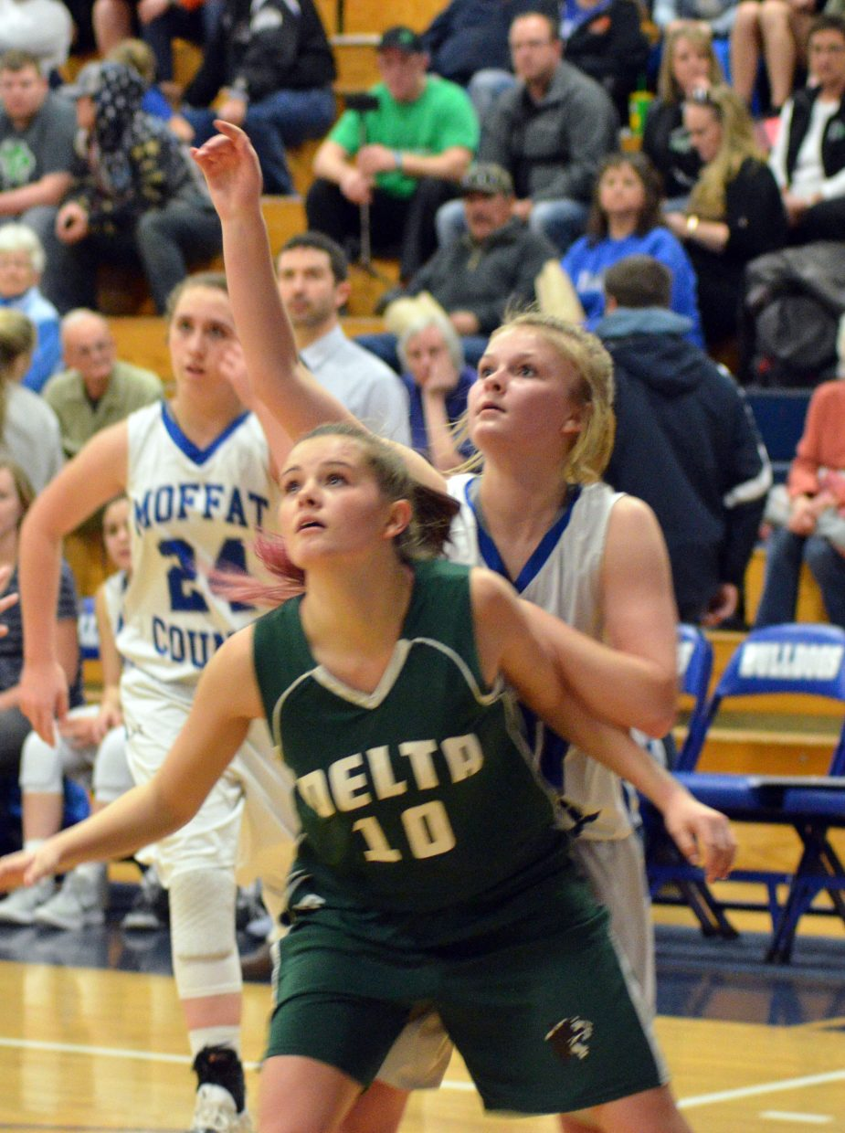 Moffat County High School's Jacie Evenson eyes her shot's trajectory against Delta.