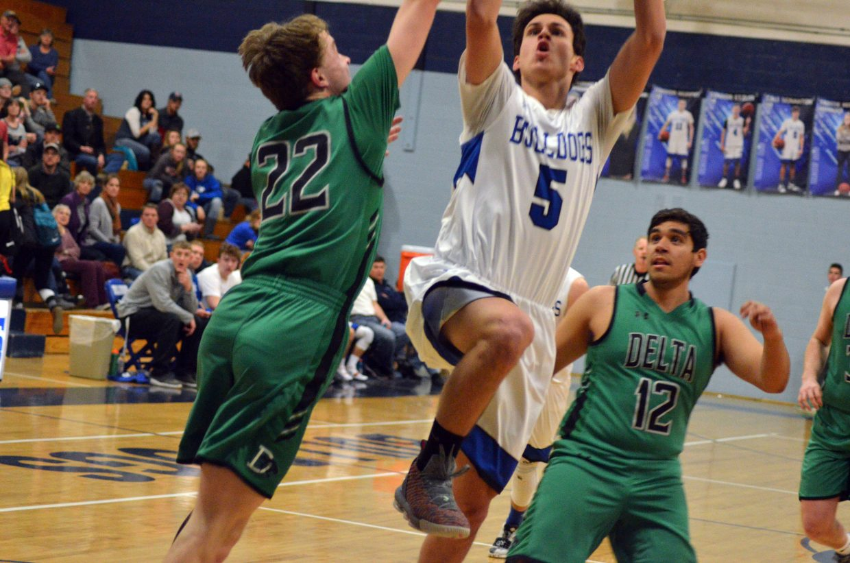 Moffat County High School's Jerod Chacon has a contested shot against Delta.