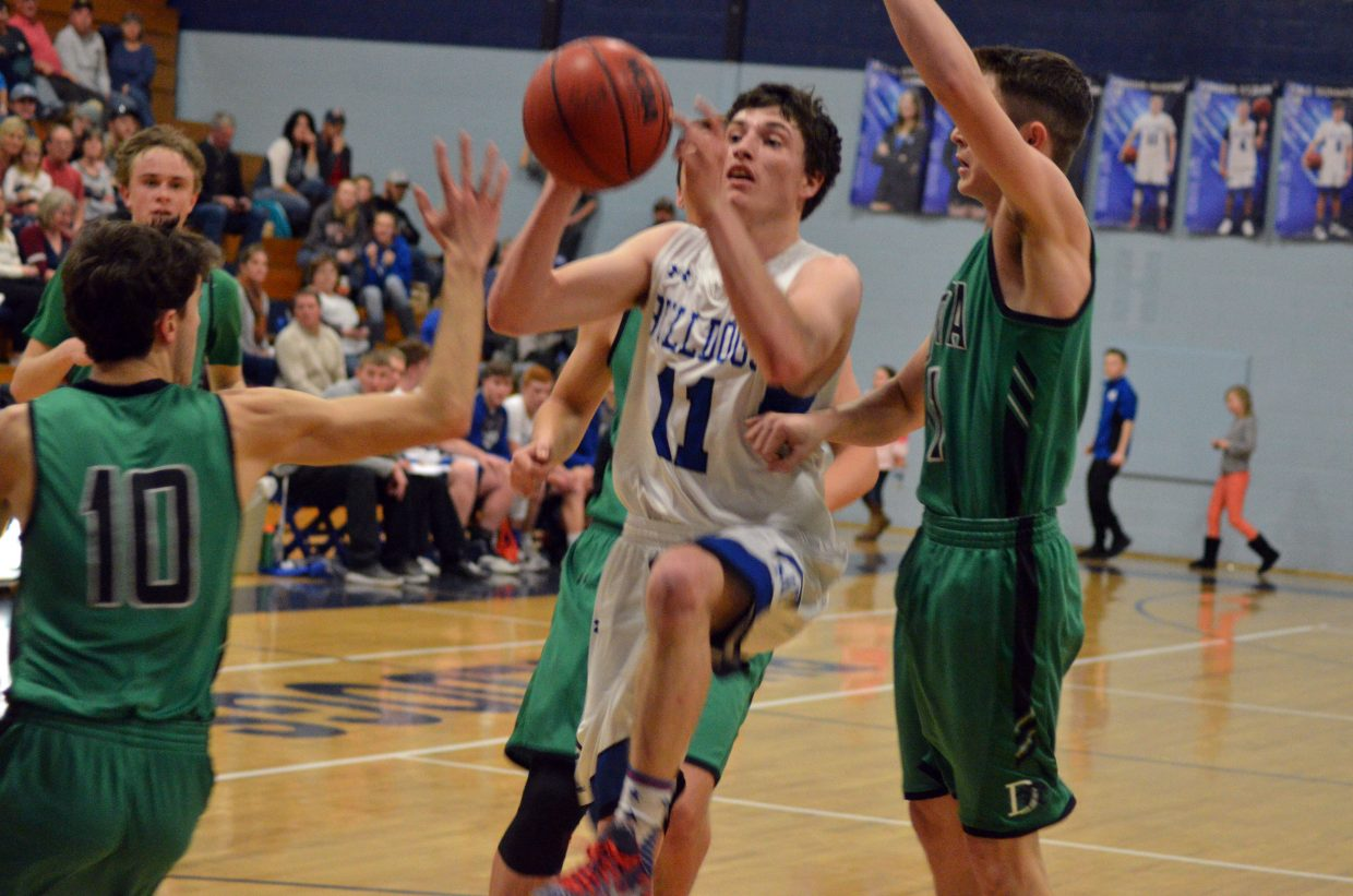 Moffat County High School's Connor Murphy fakes a layup before passing out against Delta.