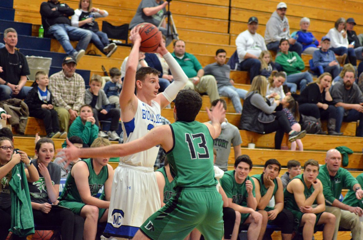 Moffat County High School's Landen Najera needs to get out of the corner against Delta.