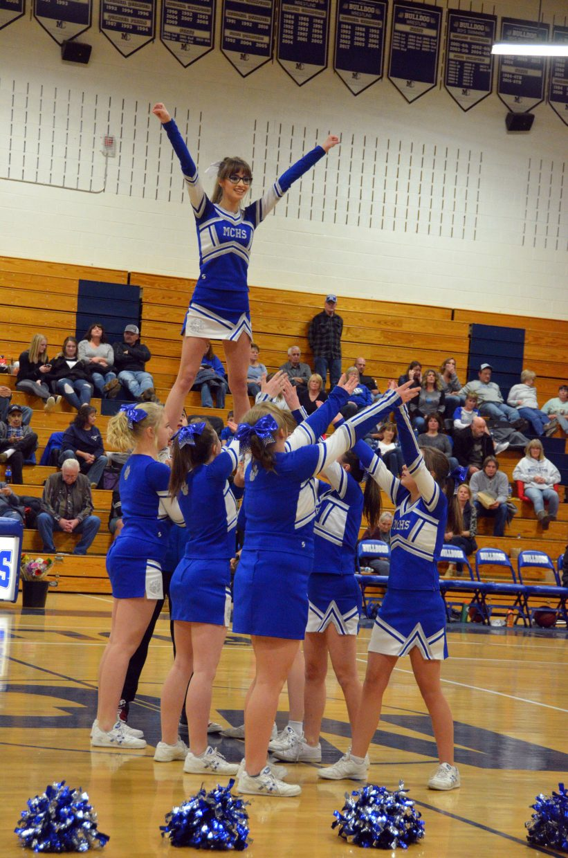 Moffat County High School cheerleaders brace to catch senior spirit squad member Abigail Hall during a stunt.