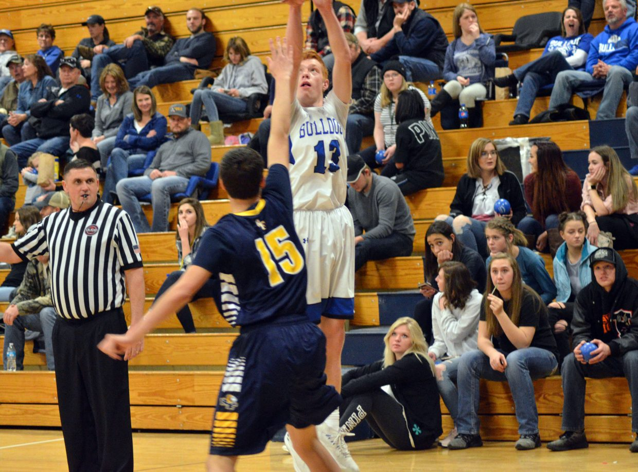 Moffat County High School's Torin Reed puts up a three-pointer against Roaring Fork.